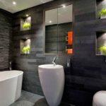 Salle de bain décorative en pierre noire et blanche