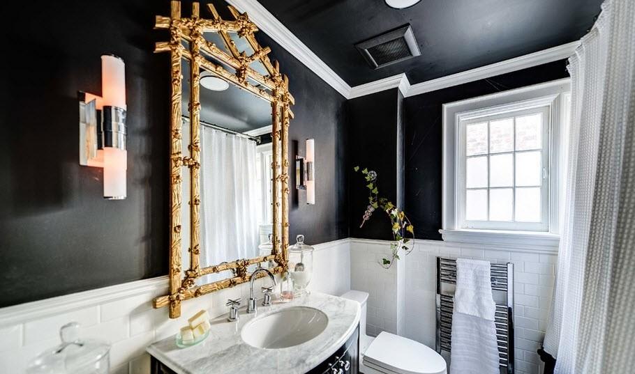 Salle de bain en noir et blanc avec un accent doré