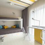 Conception d'une chambre d'enfant pour deux enfants hétérosexuels en coloris gris