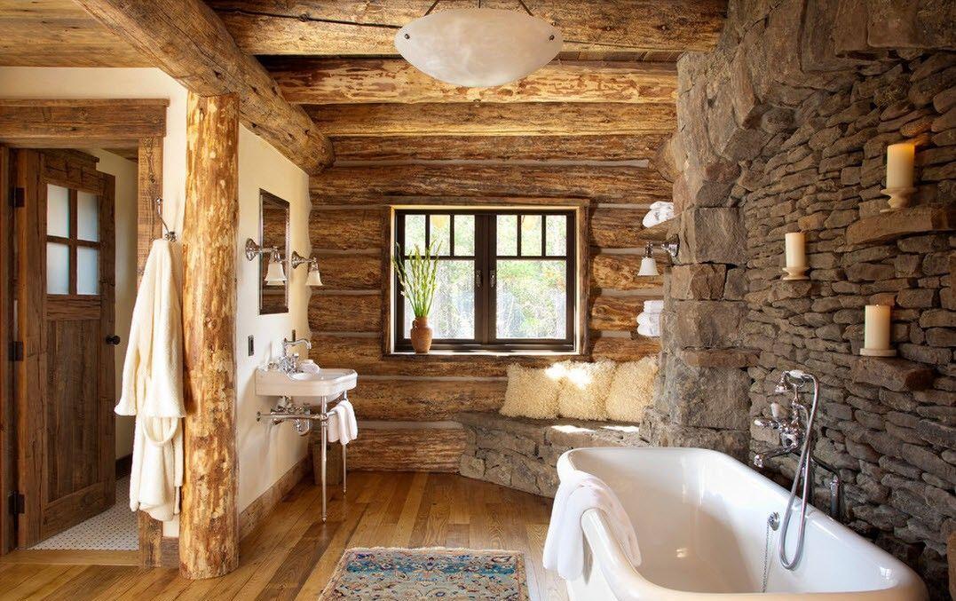 Conception de salle de bain dans une maison en bois avec garniture en pierre naturelle