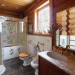 Conception d'une salle de bain dans une maison en bois rond
