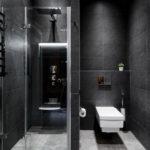 design noir et blanc d'une salle de bain avec WC