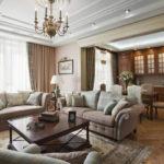 Trang trí phòng khách với ghế sofa và ghế bành ở trung tâm