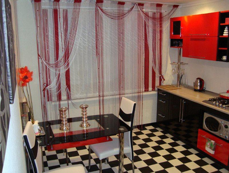 Culorile negru și roșu în designul spațiului de bucătărie
