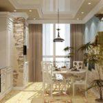 Combinând bucătărie și spațiu balcon pentru o zonă suplimentară de luat masa