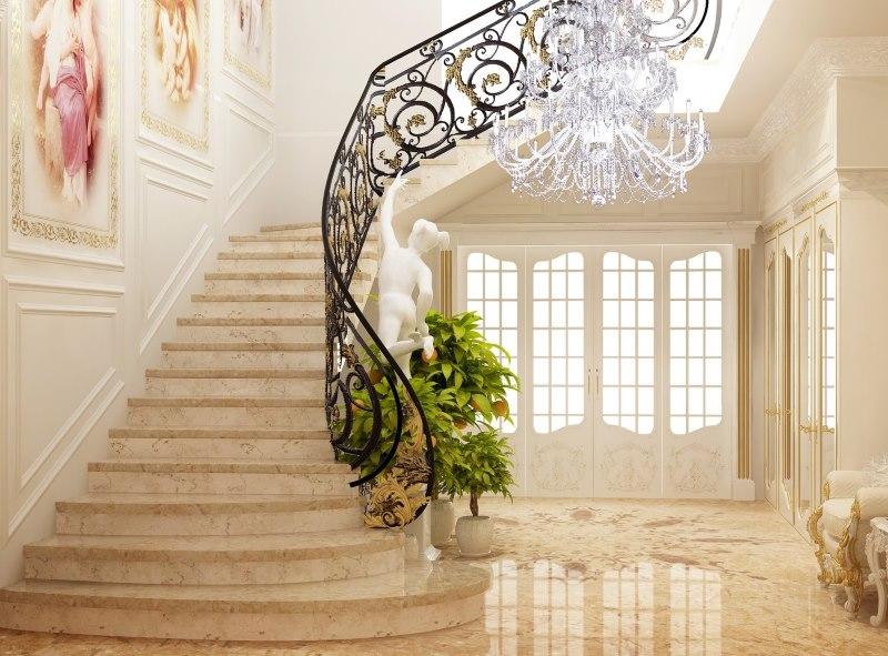 Escalier avec garde-corps en fer forgé dans le hall d'une maison privée
