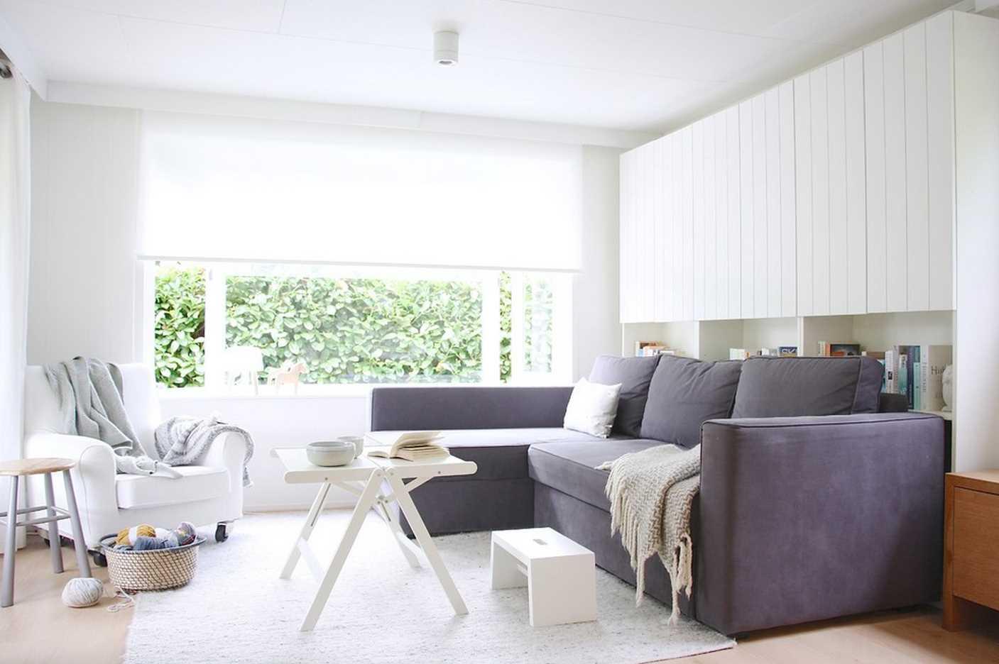 chambre-salon 18 m² avec un canapé
