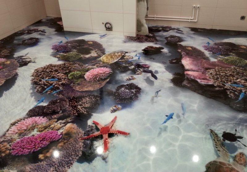 Étoiles et coraux sur le sol de la salle de bain