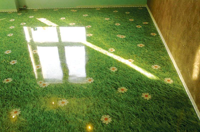 Plancher en vrac époxy avec une photo d'herbe