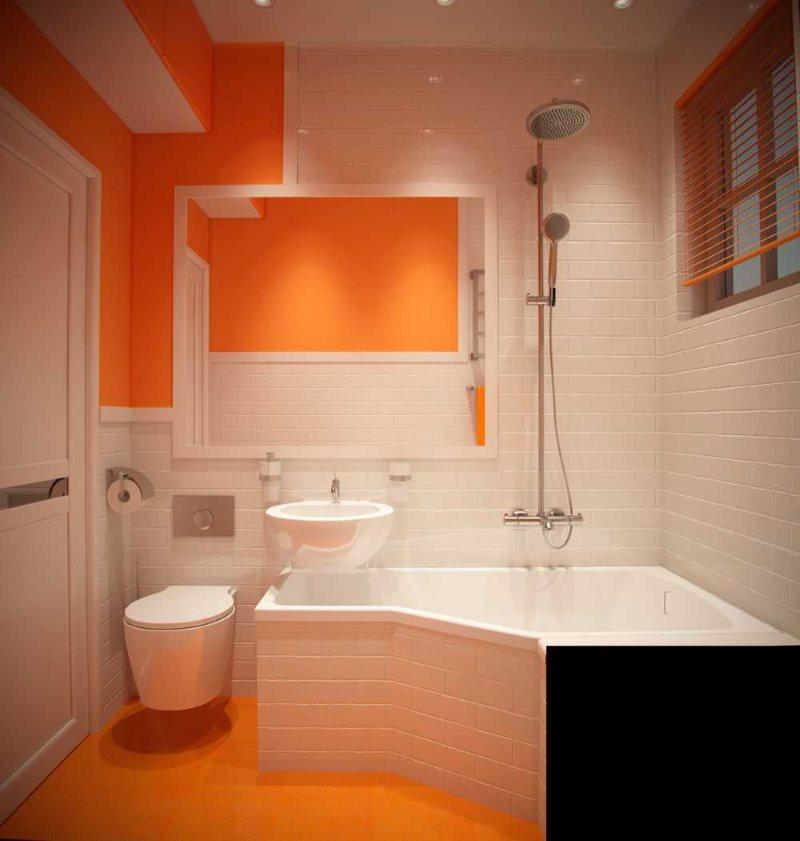 Couleur orange à l'intérieur d'une salle de bain compacte