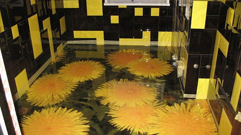 Fleurs jaunes sur le sol époxy dans la salle de bain