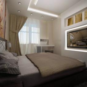 Plafond à deux niveaux dans la chambre avec une télévision