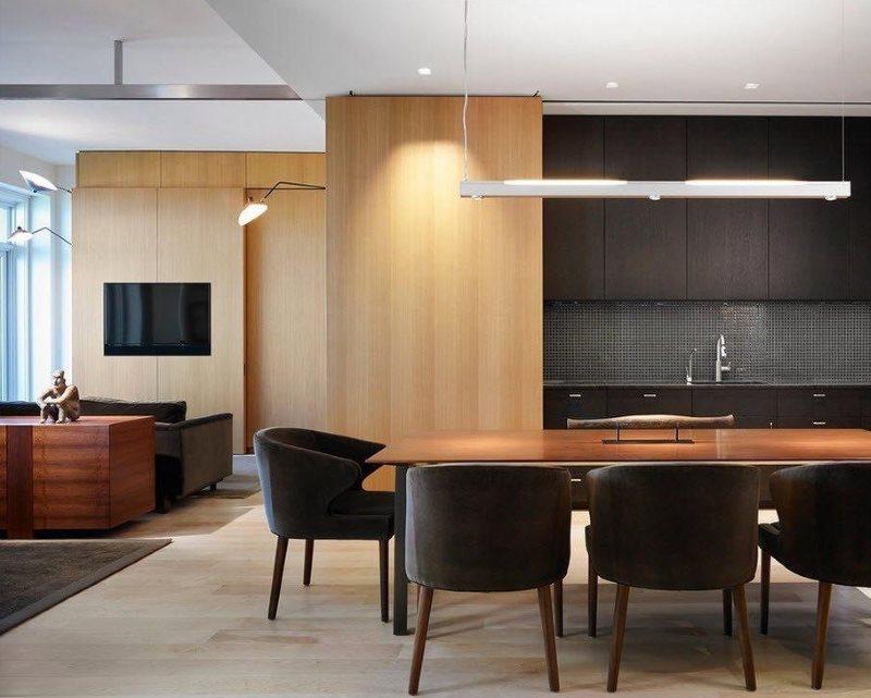 تقسيم غرفة المعيشة في المطبخ مع سجادة كبيرة