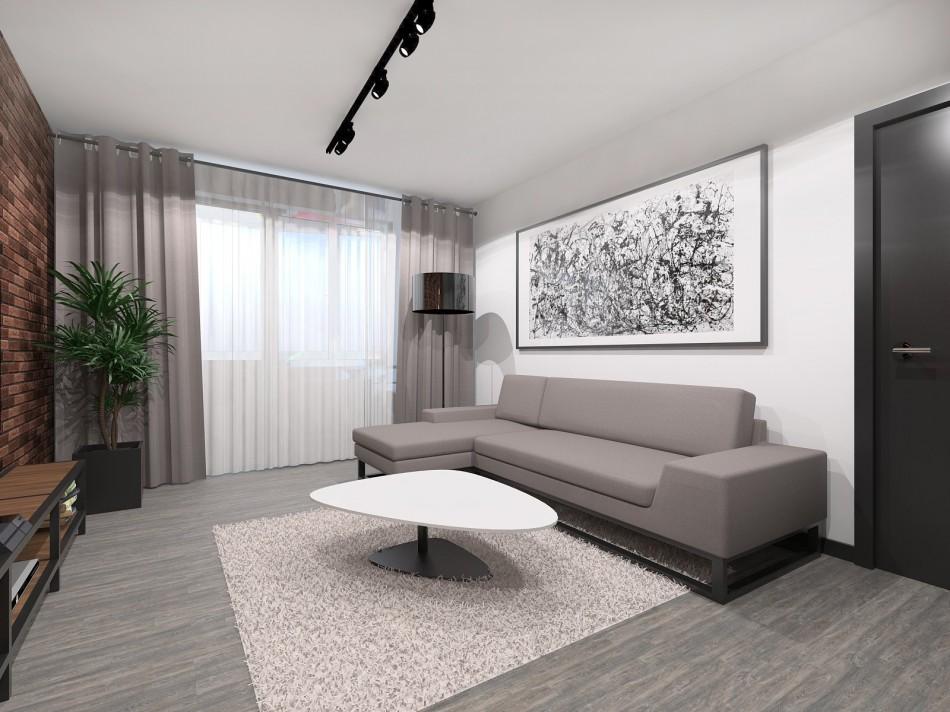 Canapé gris contre un mur blanc dans un studio