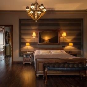 Illumination nocturne d'une chambre avec un lit en bois