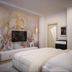 TV sur le mur de la chambre avec papier peint photo