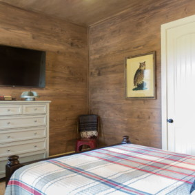 Chambre confortable dans une maison en bois