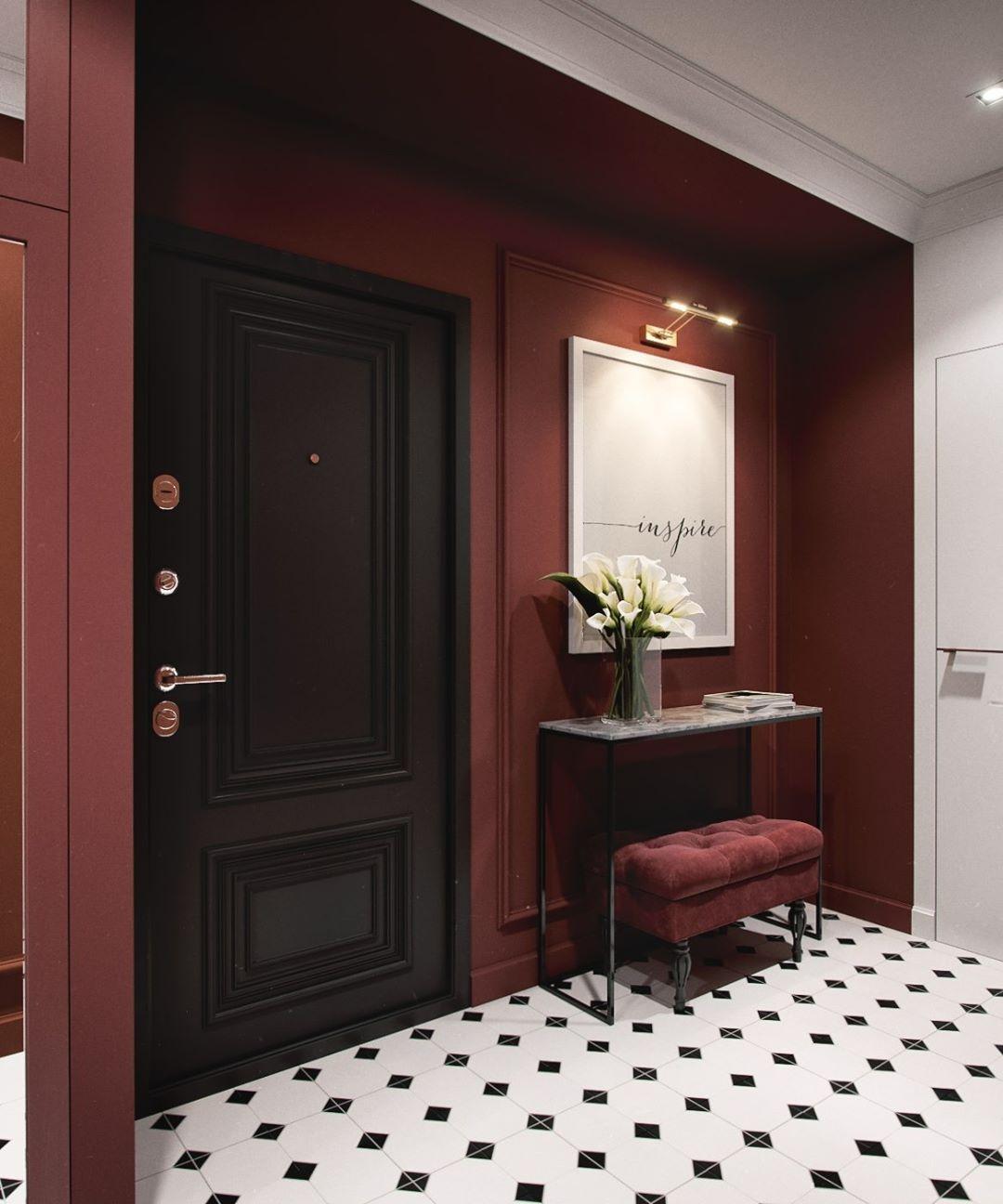 hall d'entrée avec une porte en bois