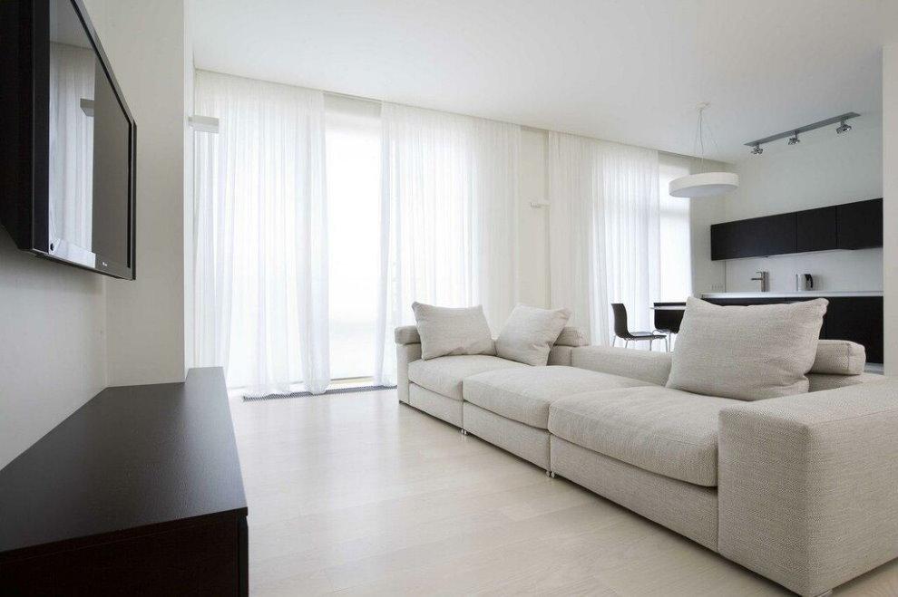 Rèm cửa màu trắng trong một căn phòng theo phong cách hiện đại.