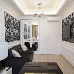 Meubles noirs dans une salle blanche