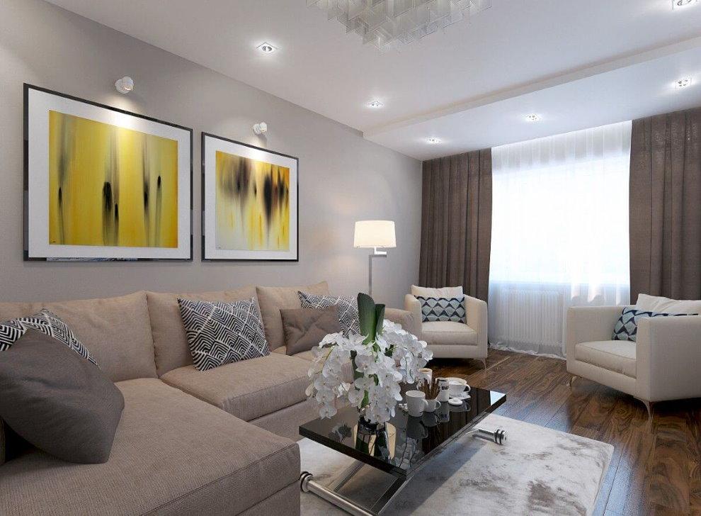 Peintures modulaires sur le canapé d'angle du salon