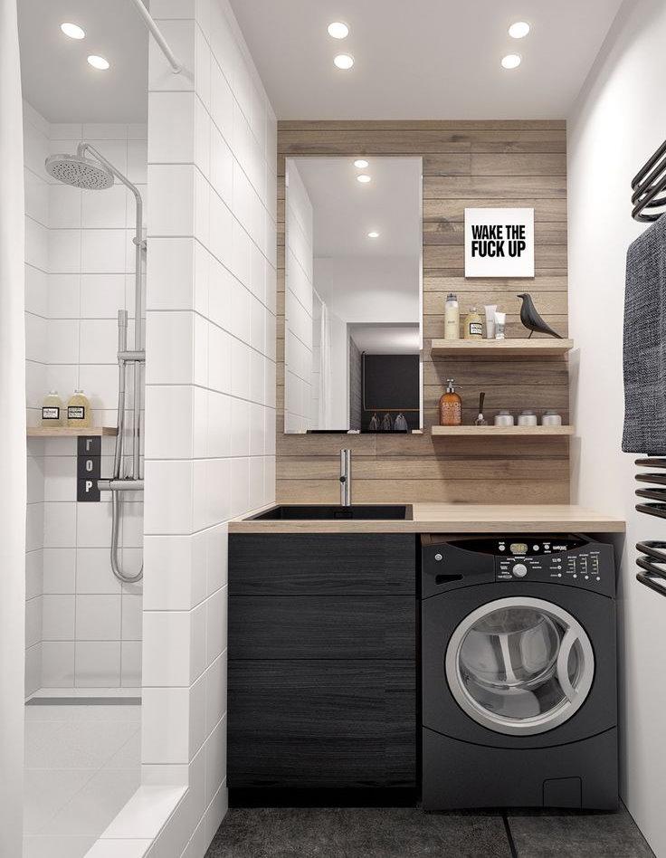 Place pour une machine à laver sous le comptoir dans la salle de bain