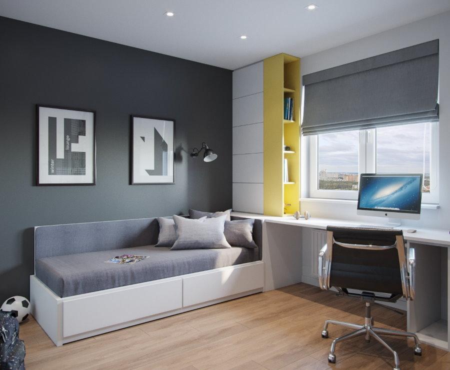 Murs gris d'une pépinière avec des meubles blancs