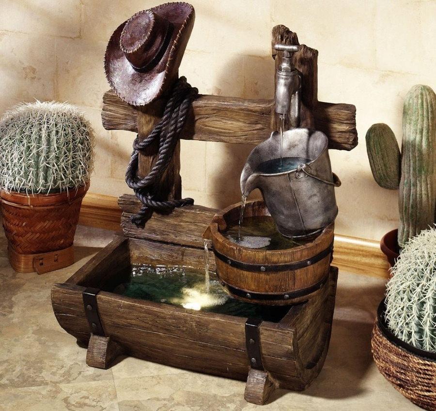 Fontaine décorative en bois sur une table dans le hall