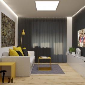 Accents jaunes dans un intérieur de salon gris