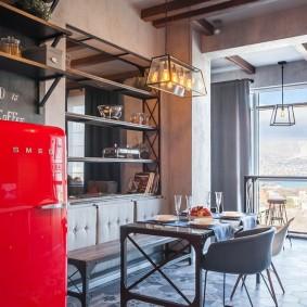 Réfrigérateur rouge dans la cuisine de style loft