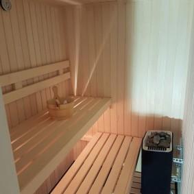Louche en bois sur un banc dans le bain