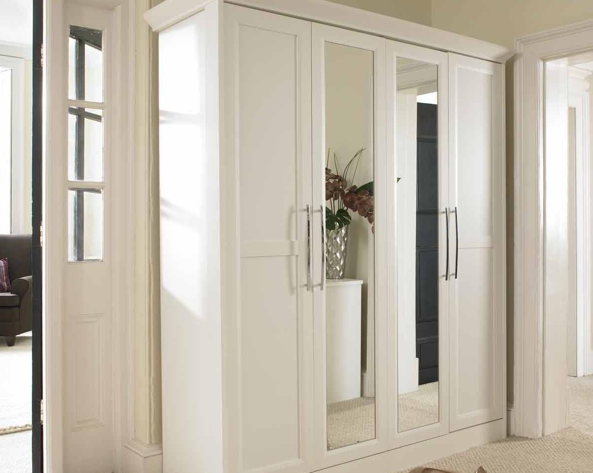 armoire à charnière blanche avec miroir